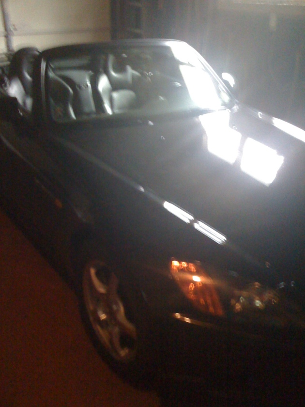 I know it's a terrible shot... closed garage, light through the window.  Anywho, here's the real car.